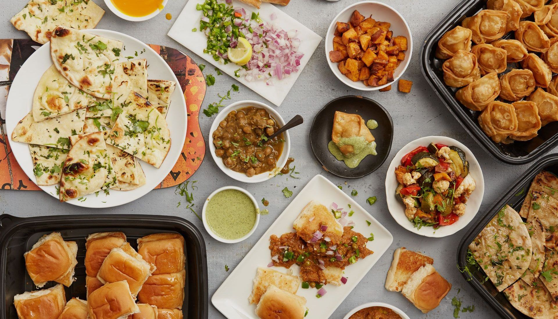 catering appetizers including naan, wheat naan, pav bhaji, samosas and chickpea masala