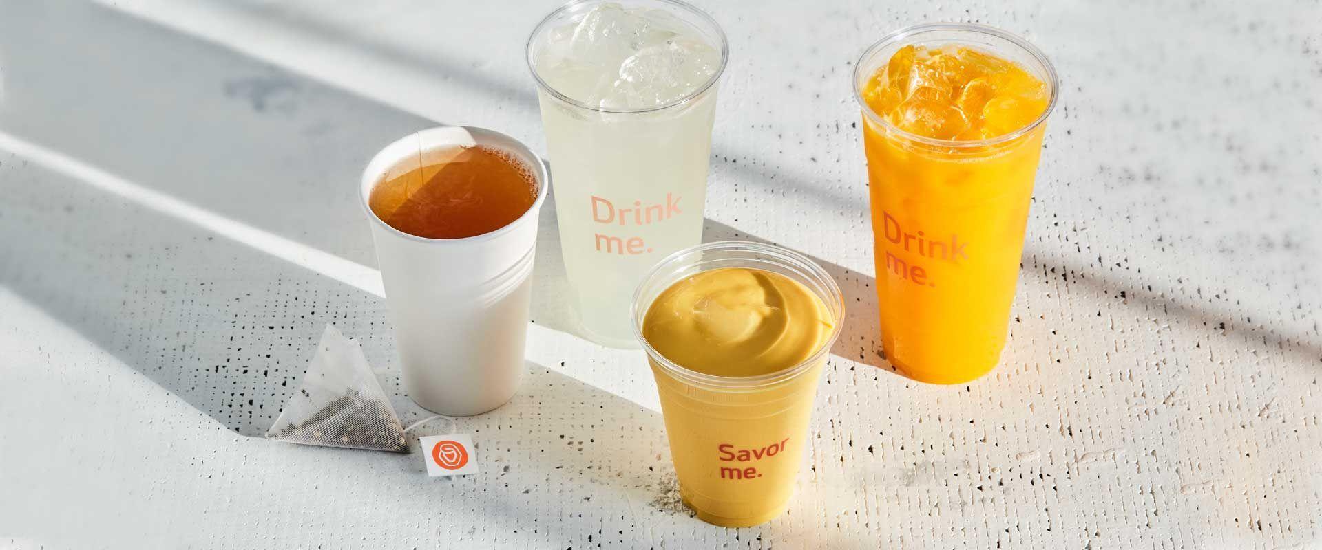 hot organic teas, mint ginger lemonade, mango lemonade and mango lassi on a table