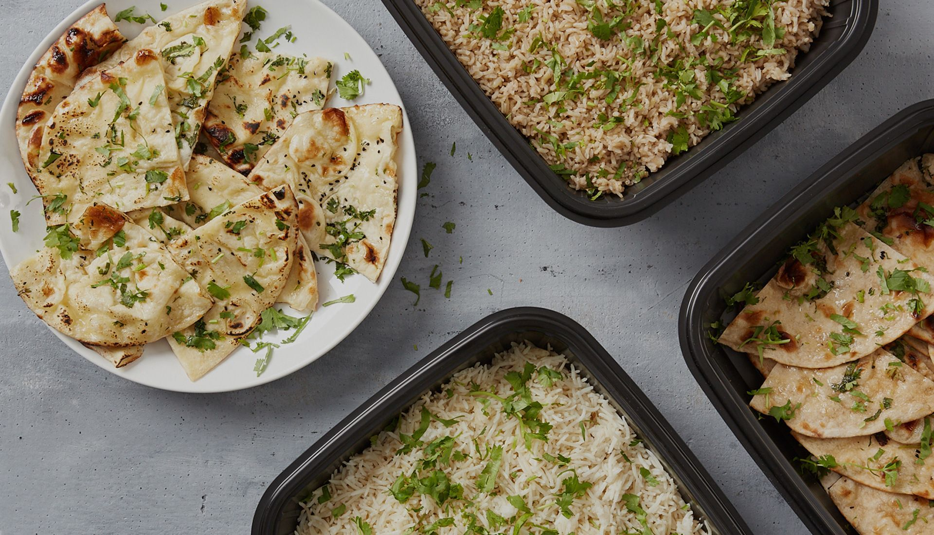 white basmati rice, brown basmati rice, wheat naan and naan on grey background