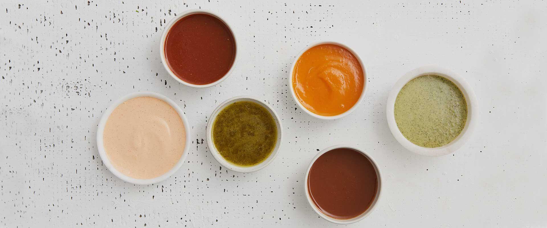 sauces and chutneys on a table
