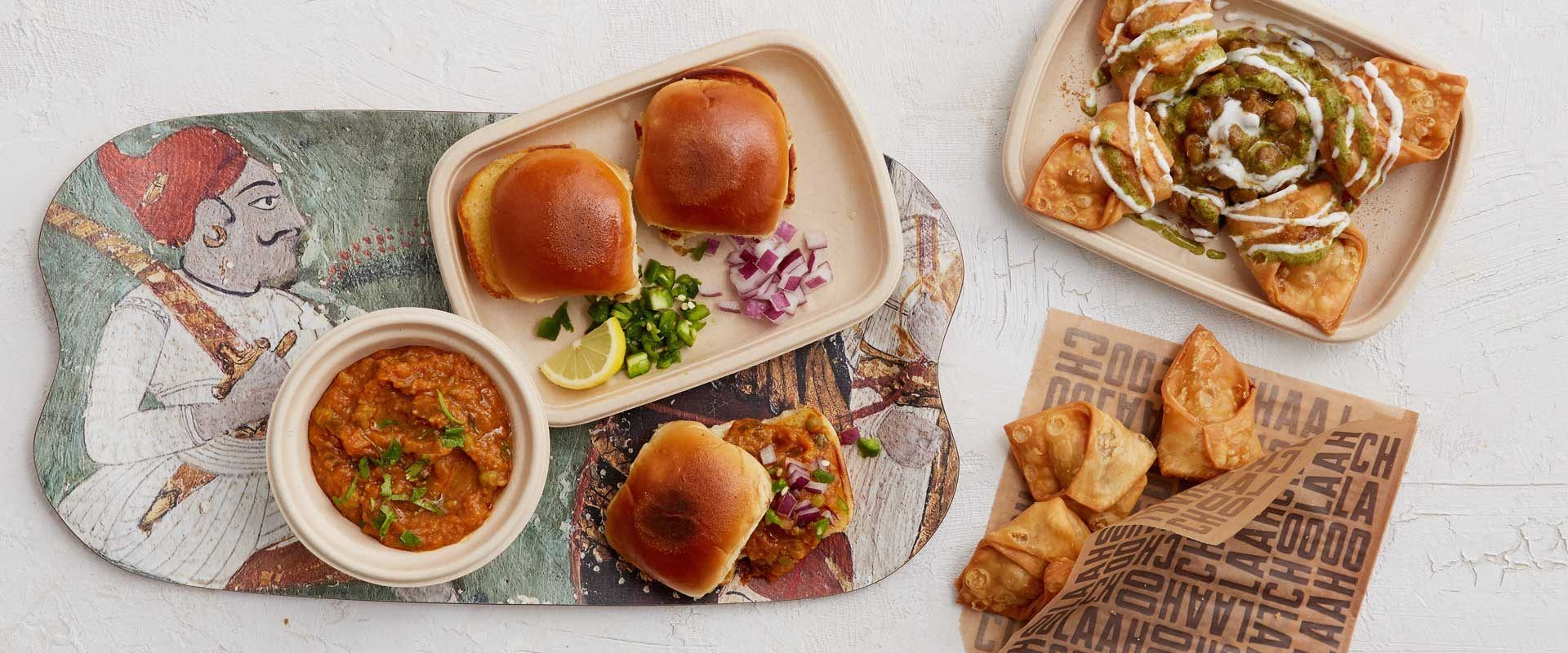 Pav Bhaji, samosas and samosa chaat on a table