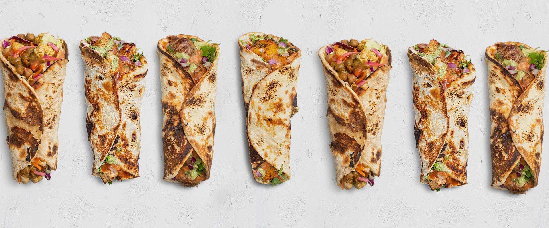 chicken wrap, paneer wrap, lamb wrap and vegan chickpea wrap