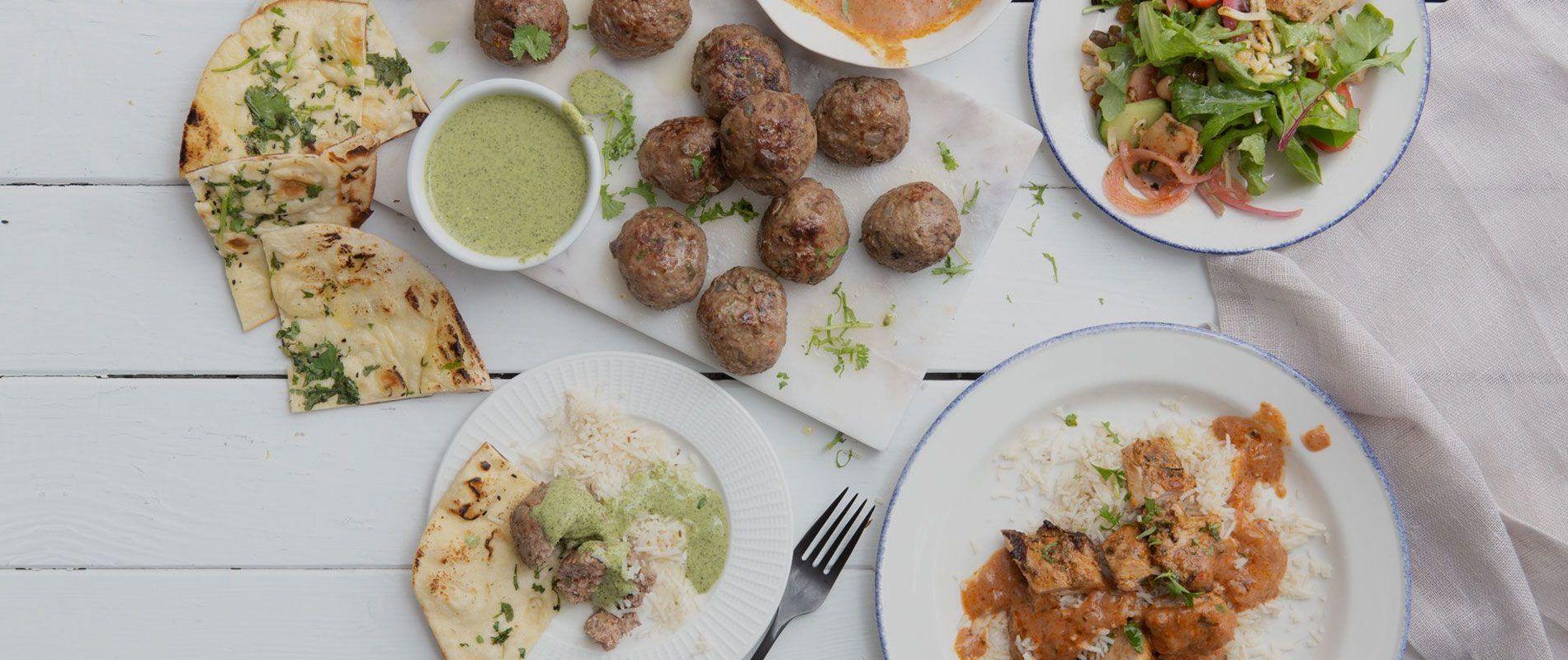 catering meal with naan, halal lamb meatballs, basmati rice, tikka masala and salad