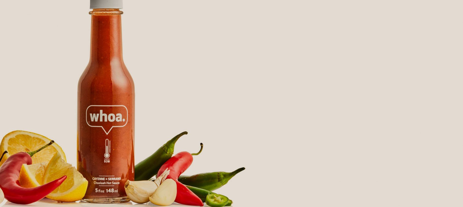 whoa hot sauce bottle with lemon, garlic and cayenne peppers