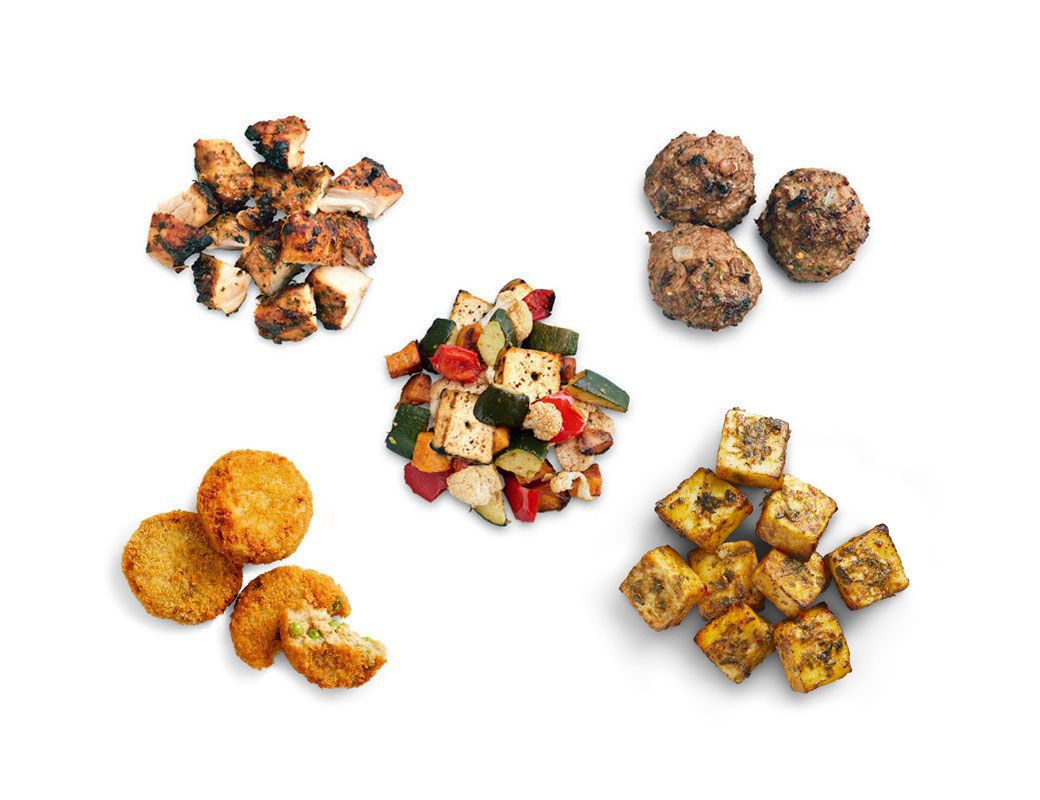 tandoori chicken, halal lamb meatballs, roasted veggies, veggie croquettes and panner on white background.
